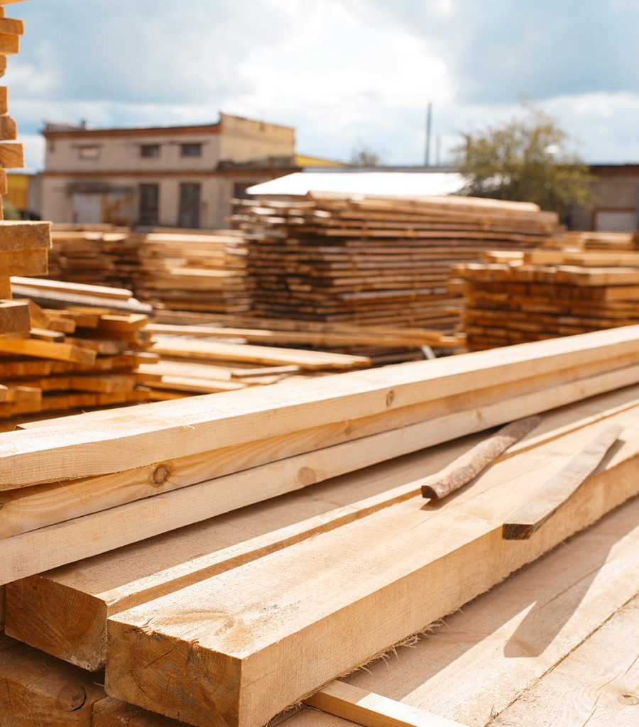 Boards on timber mill warehouse outdoor, nobody, lumber industry, carpentry. Wood processing on factory, forest sawing in lumberyard, sawmill